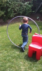 hula hoop made into a tunnel to run through