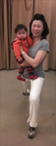 Woman holding baby while lunging