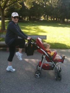 Mom exercises with baby in the stroller