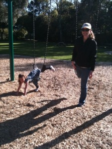 mother and daughter playing games on swings