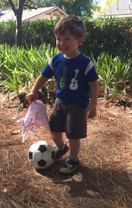 A boy enjoys playing soccer